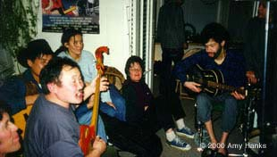 photo: Paul and Kongar-ol Ondar and company having a party at Paul's house in Jan 2000