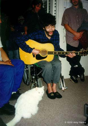 photo: Paul & his cat Lyuba at the Jan 2000 party with the Tuvans